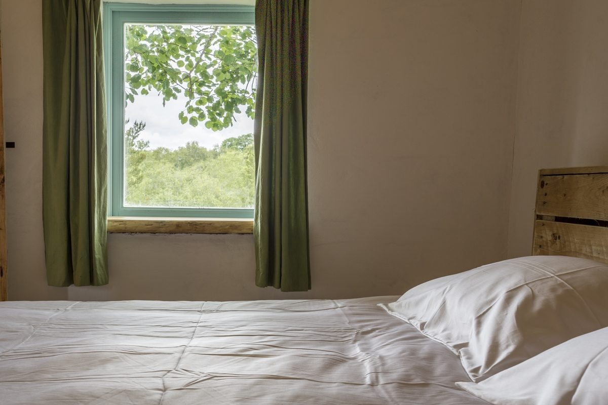 The tranquil bedroom overlooks the birch woodland